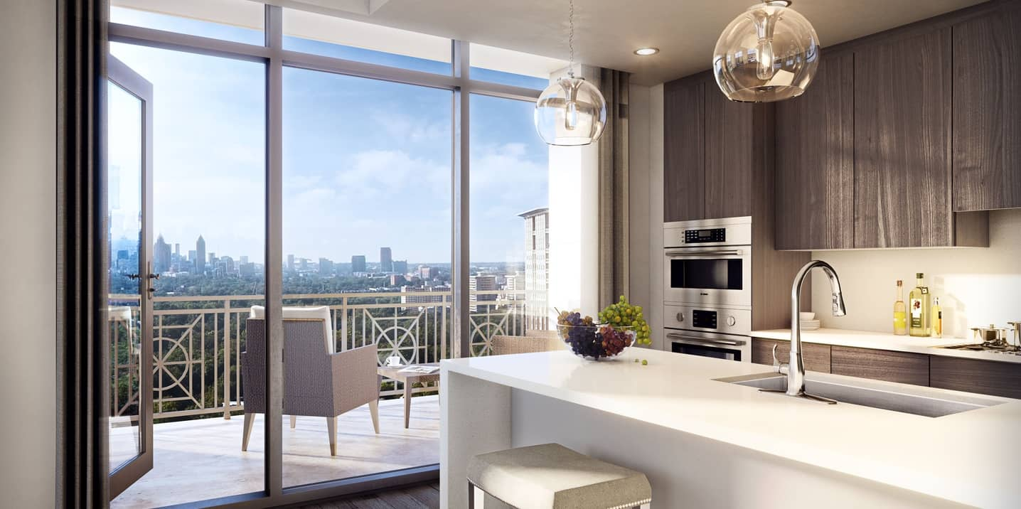The Sutton Buckhead apartment kitchen interior with balcony view of Atlanta skyline