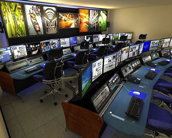 aerospace defense control room with consoles and monitors
