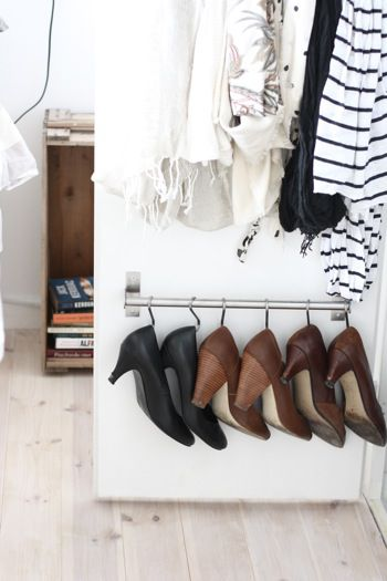 organized shoe hooks in closet