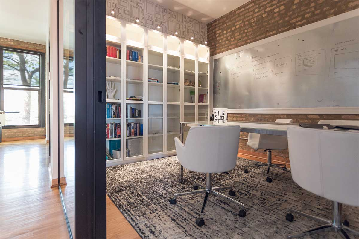 office room with white chairs