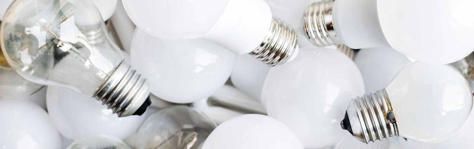led light bulbs mixed with conventional light bulbs in pile