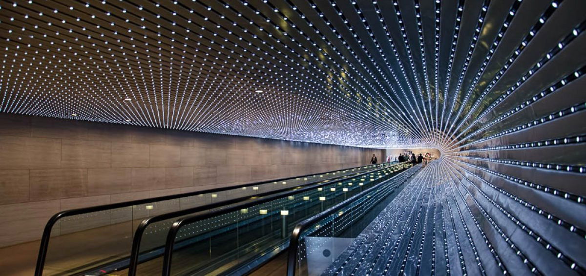 LED lighting indoors around walking escalator